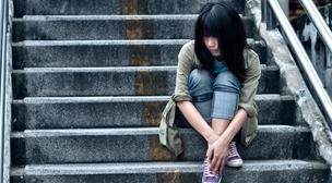 Asian young woman on steps